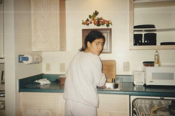 This was within the first couple months after they arrived in 1995. My mom was only 20 years old. She was making caldo de pollo in this picture.